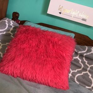 Fluffy vibrant pink accent pillow